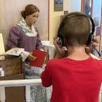 museum patron wears noise canceling headphones