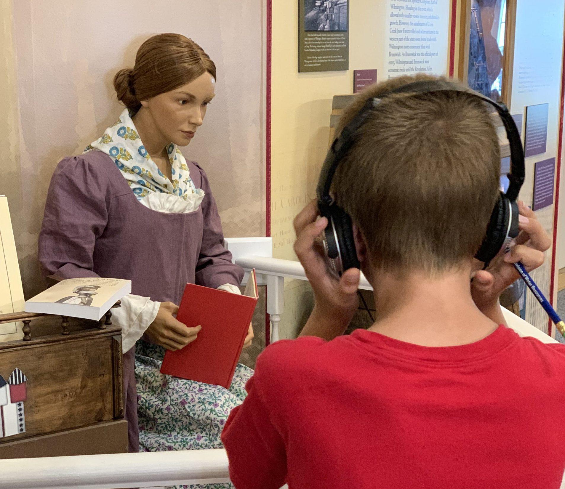 boy wearing noise-canceling earphones