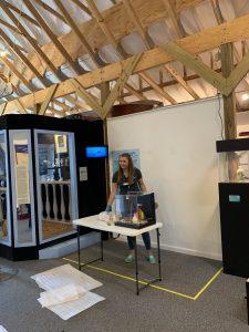 Education Curator Katy Menne installs new exhibit