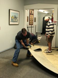 Museum volunteers help with facility repairs and upkeep
