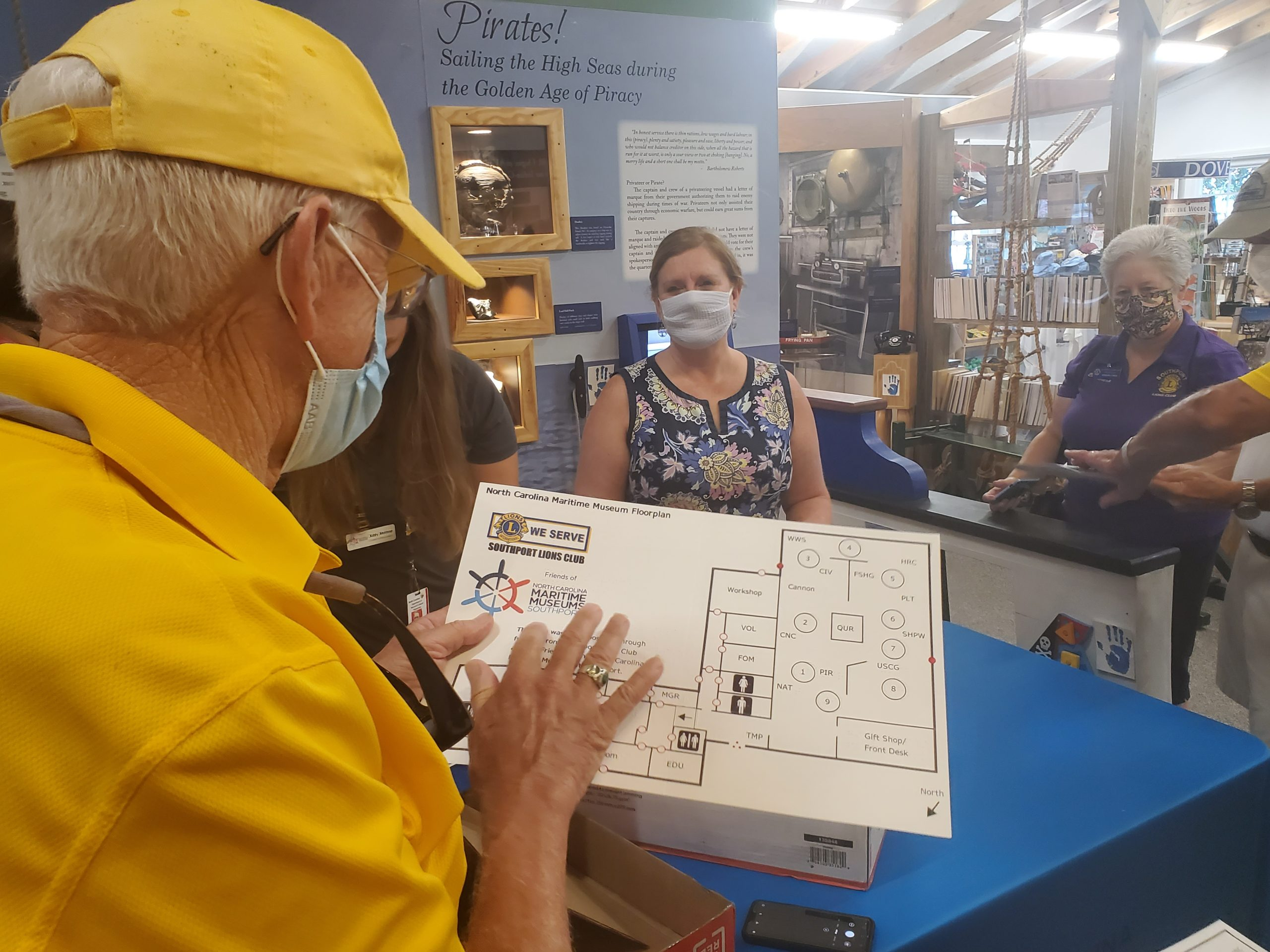 Lions club member holding new tactile map